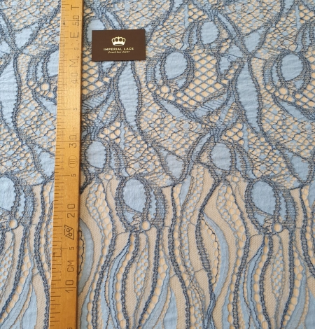 Light and dark blue chantilly lace fabric . Photo 9