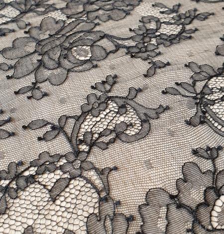Black elastic chantilly lace fabric. Photo 5
