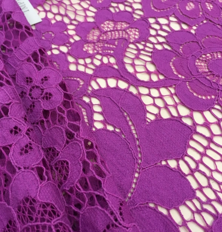 Purple lace fabric. Photo 1