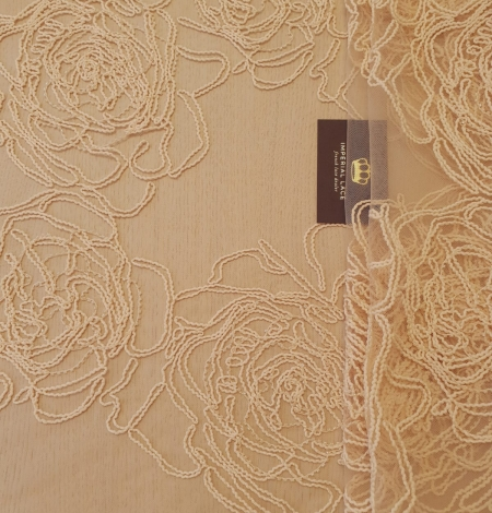 Light peach color big floral pattern thick thread embroidery on tulle fabric. Photo 1