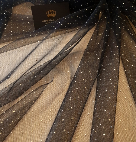 Black with gold dotted pattern tulle fabric. Photo 1