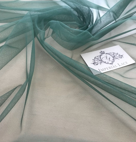 Green tulle fabric. Photo 9
