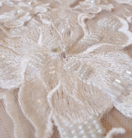 Ivory beaded floral pattern embroidery on tulle fabric. Photo 4