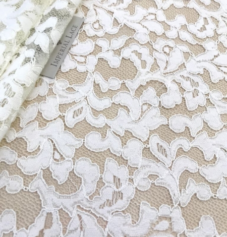 Ivory lace fabric with flowers. Photo 1