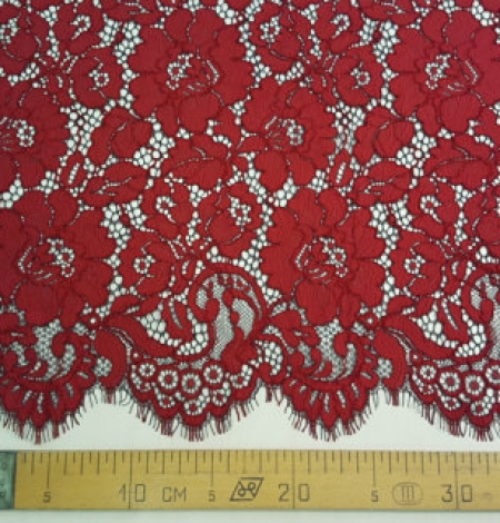 Red with black guipure lace fabric . Photo 5