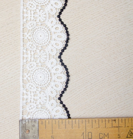 Ivory with black edge floral pattern macrame lace trim. Photo 6