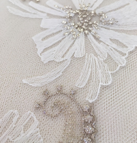 White soft embroidery on peach tulle. Photo 2