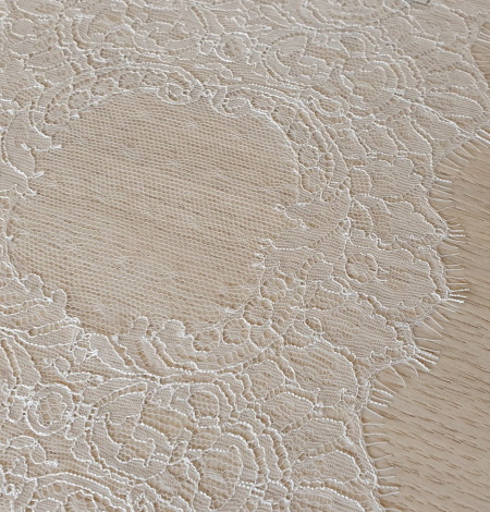 Ivory chantilly lace trimming from France. Photo 1