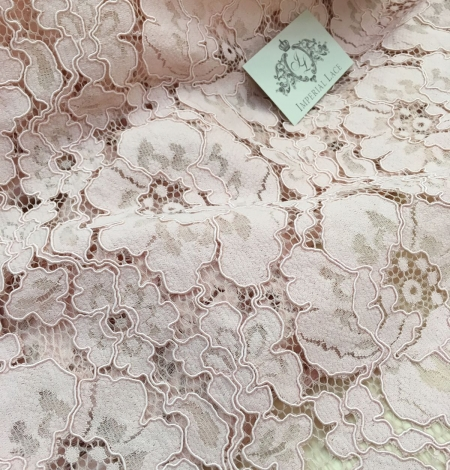 Light Pink Lace Fabric. Photo 1
