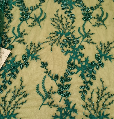Green beaded lace fabric. Photo 1
