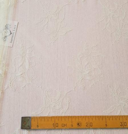 Light yellow lace fabric. Photo 10