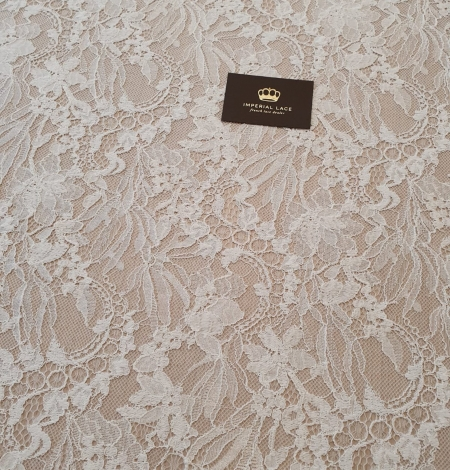 Ivory floral pattern chantilly lace fabric. Photo 5