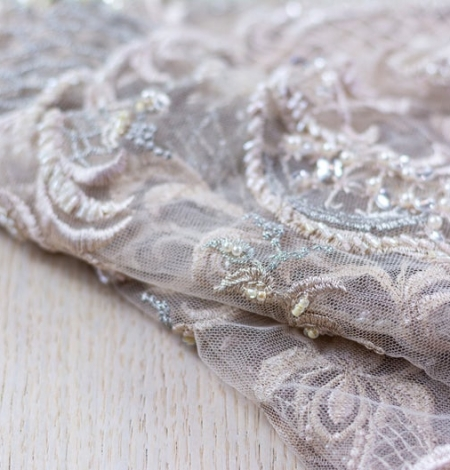 Beige embroidery on tulle fabric. Photo 5