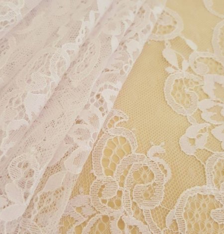 White with lilac shade chantilly lace fabric. Photo 1