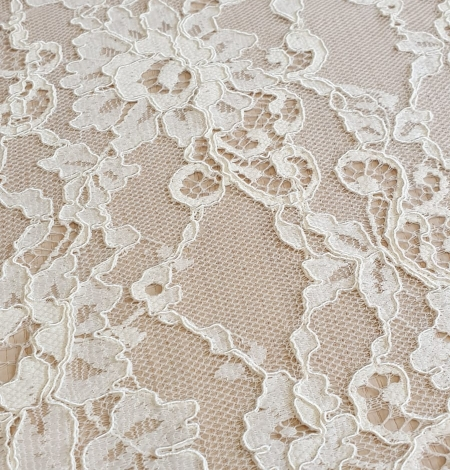 Champagne guipure lace fabric. Photo 3