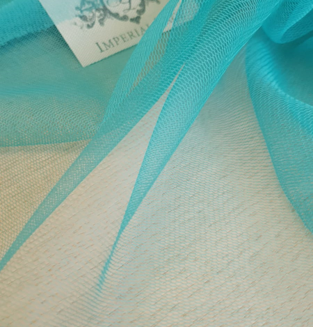 Turquoise silk tulle fabric. Photo 6