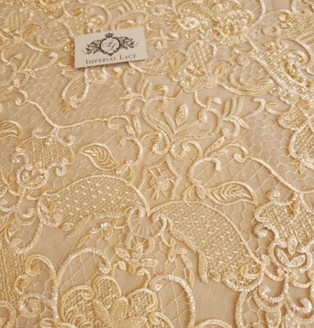 Yellow beaded lace fabric. Photo 3