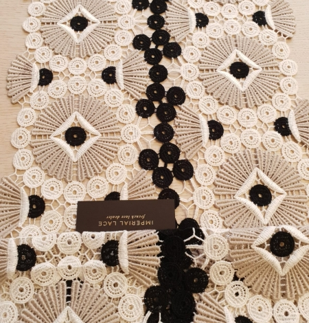 Beige with black and white macrame lace fabric. Photo 5