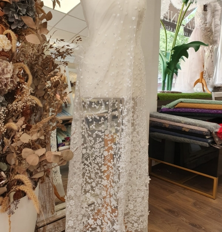 Ivory floral growing embroidery on tulle lace fabric. Photo 12