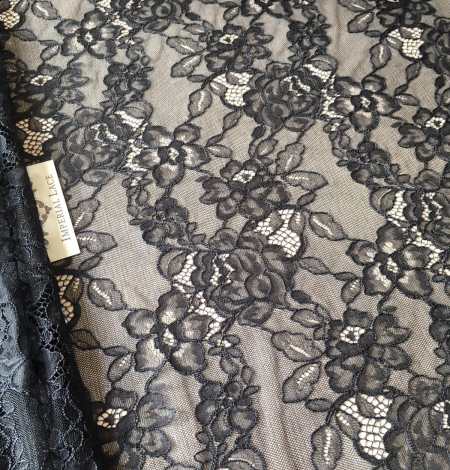 Black floral pattern lace fabric . Photo 4