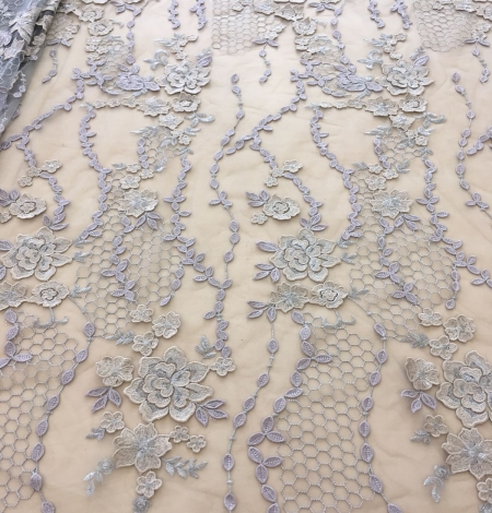 Greyish blue embroidery on tulle fabric. Photo 2