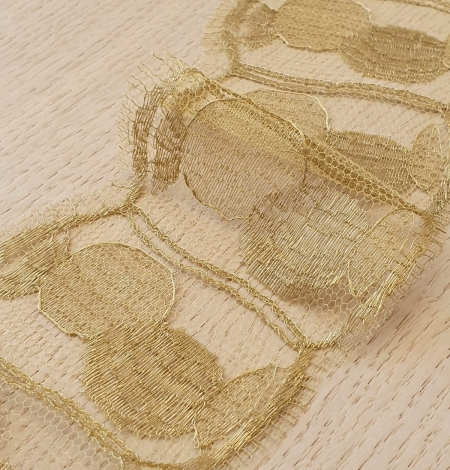 Gold chantilly lace fabric. Photo 3