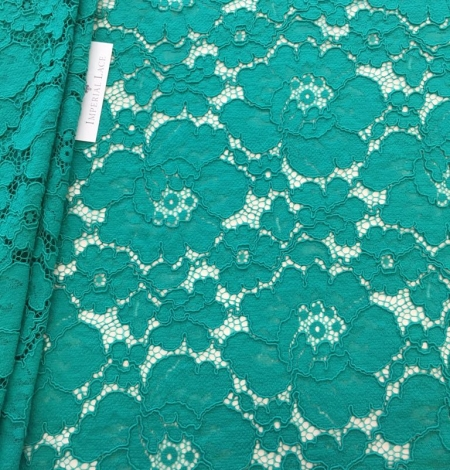 Green floral pattern guipure lace fabric. Photo 1