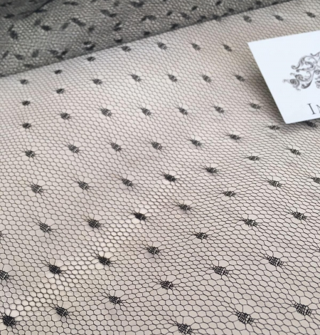 Black stiff tulle fabric with dots. Photo 1