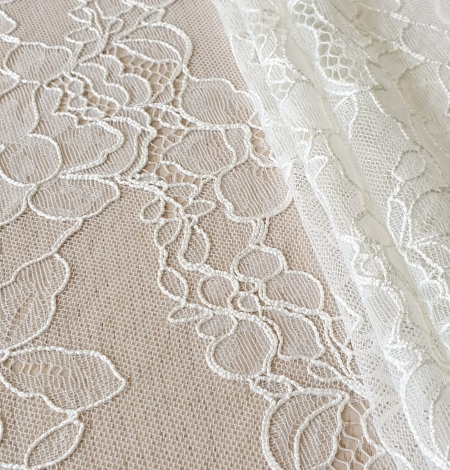 Ivory chantilly lace with thick thread lace fabric . Photo 4