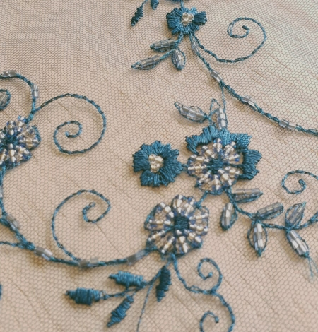 Turquoise embroidery lace fabric. Photo 3
