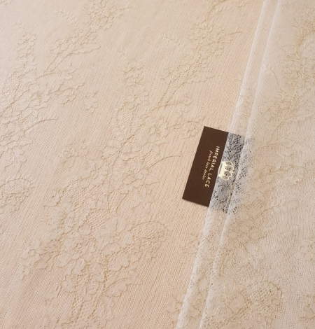 Ivory and grey with gold thread chantilly lace fabric. Photo 1