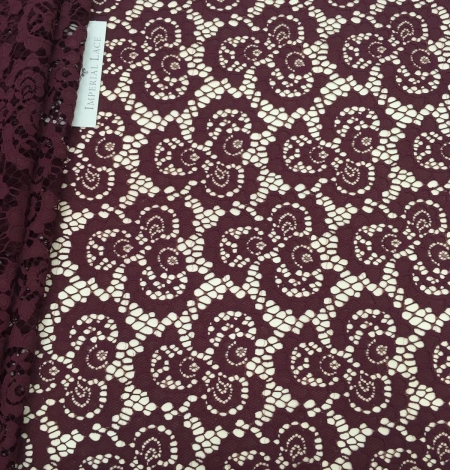 Wine red lace fabric. Photo 1