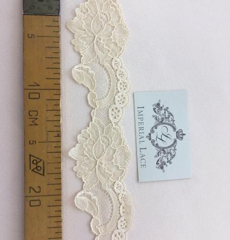 Sand yellow elastic lace trim. Photo 9