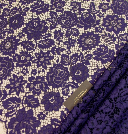Dark purple floral guipure lace fabric . Photo 1