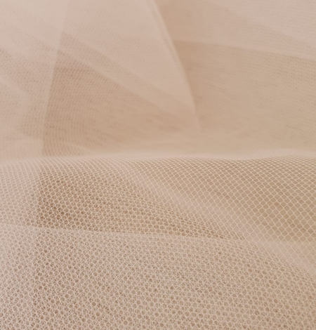 Light pink middle hard tulle fabric. Photo 9