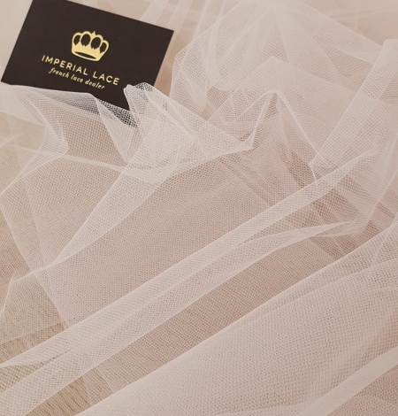 Light pink middle hard tulle fabric. Photo 6
