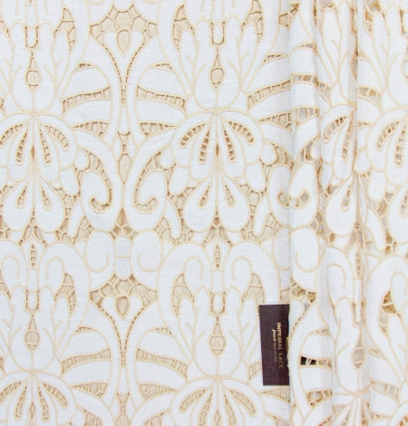 White with light brown macrame lace fabric . Photo 1