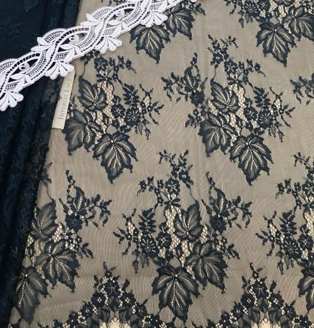 Dark green lace fabric. Photo 4