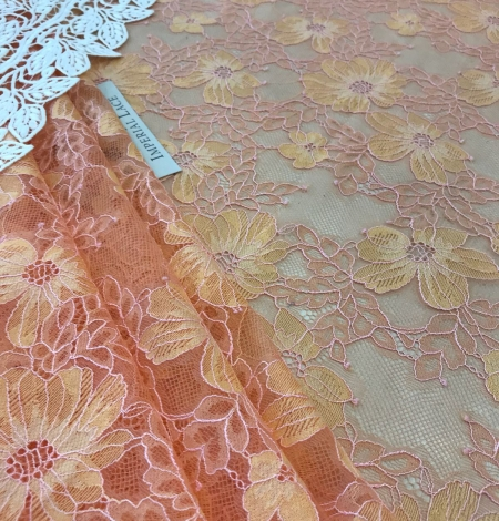 Orange lace fabric. Photo 1