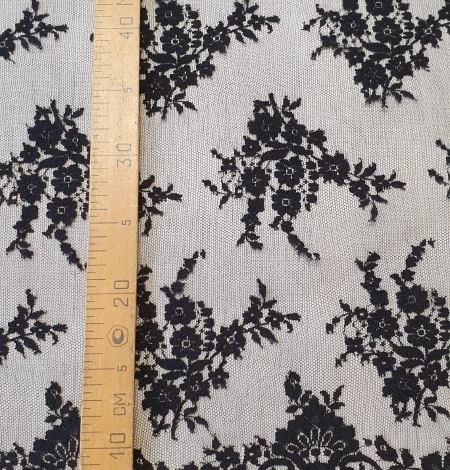 Black floral chantilly viscose lace fabric. Photo 10