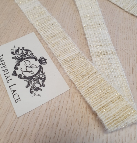 Ivory with gold thread rubber ribbon. Photo 1