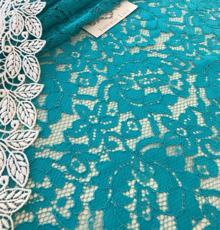 Blue French lace fabric. Photo 1