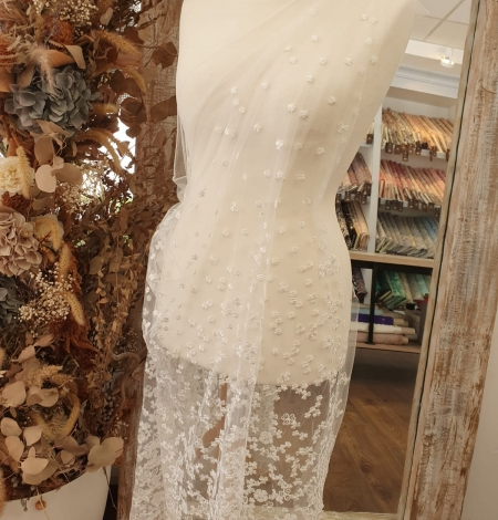 Ivory floral growing embroidery on tulle lace fabric. Photo 11