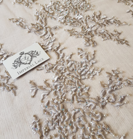 Beige embroidery on tulle fabric . Photo 1