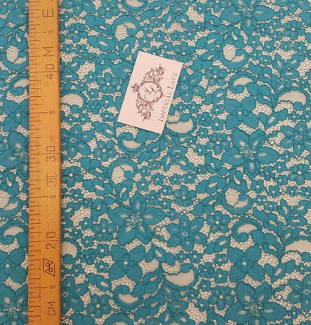 Turquoise guipure lace Fabric. Photo 5