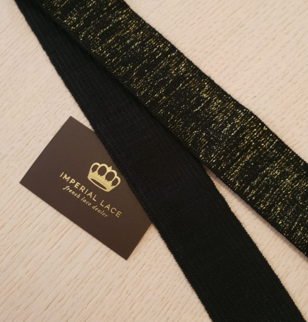 Black with gold rubber ribbon application. Photo 5