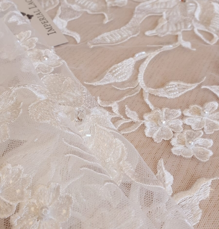 Ivory beaded floral pattern embroidery on tulle fabric. Photo 3