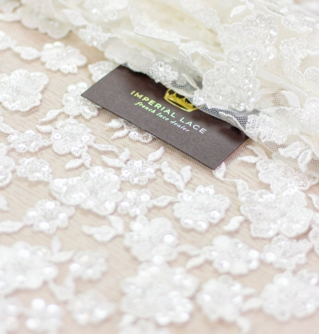 Ivory floral pattern beaded embroidery on tulle fabric. Photo 1