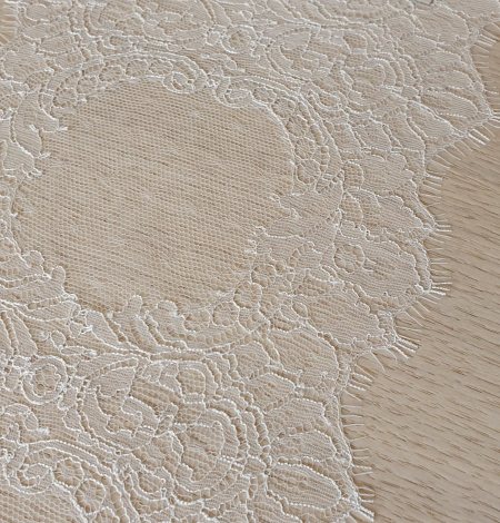 Ivory chantilly lace trimming from France. Photo 3