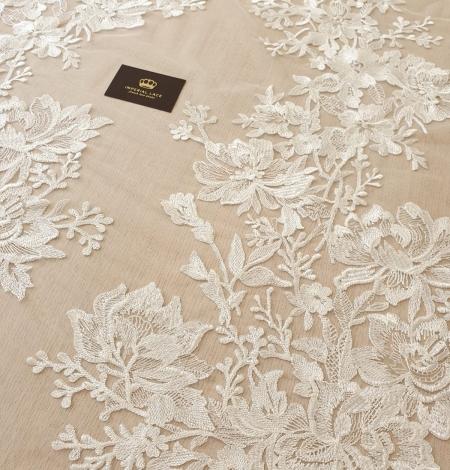 Ivory 100% polyester floral pattern embroidery lace fabric. Photo 5